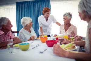 nurse talking to group of seniors